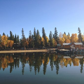 reflection of fall coloured trees on lake in Autumn at Sunset Bay Resort