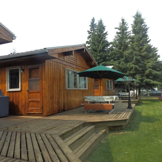 exterior of cabins with decks, picnic tables and bbqs
