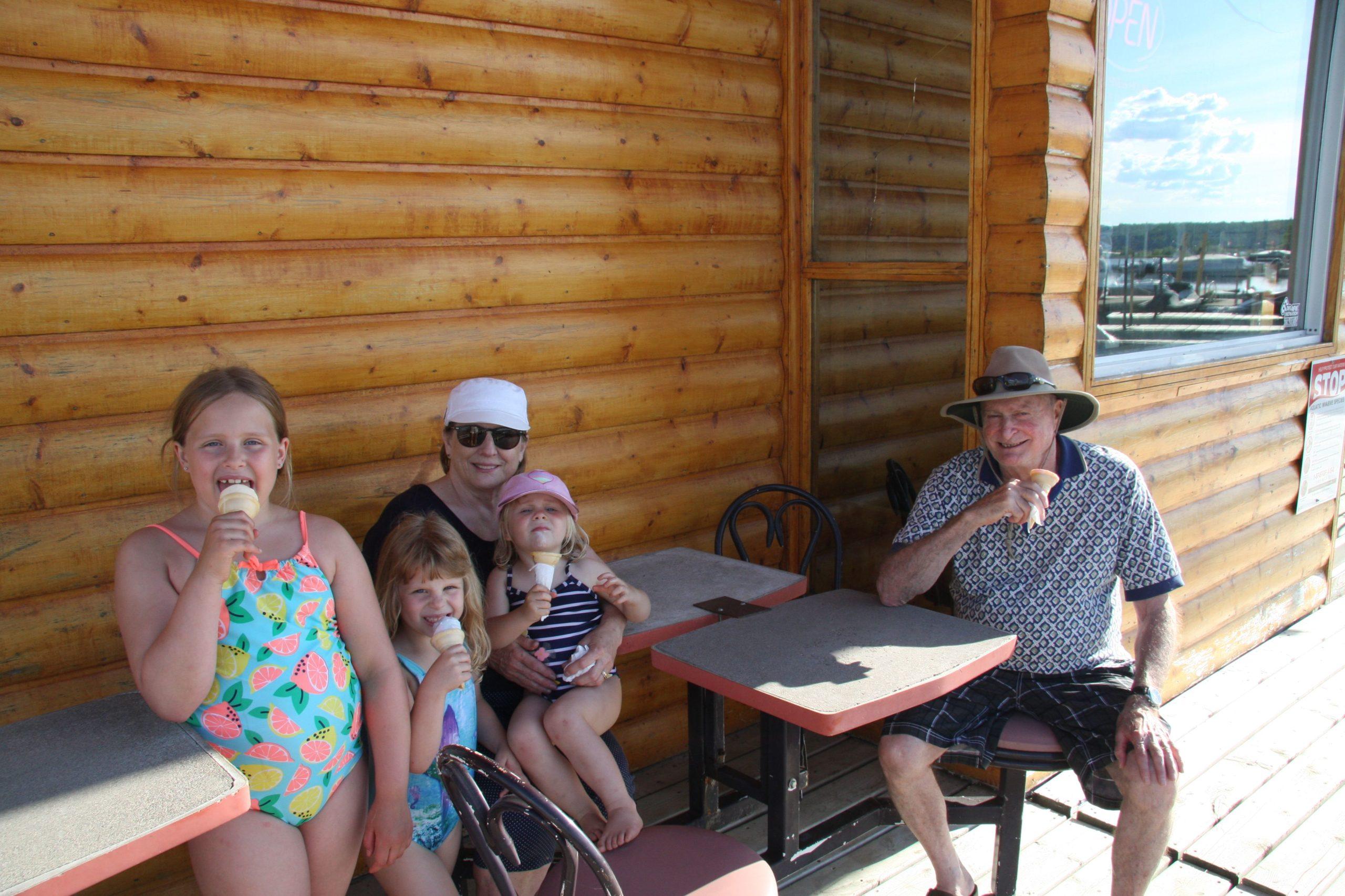 family eating ice cream at Emma Lake